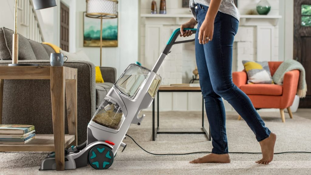 a women cleaning carpet with advance carpet cleaning equipment